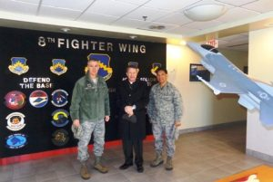 Archbishop Timothy Broglio in South Korea with Col. John W. Pearse, Commander at Kunsan Air Base (left) and Father Mario Catungal