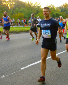 Father Luke Willenberg, CH (CPT), USA, led Team AMS across the finish line in the 41st annual Marine Corps Marathon on Oct. 30, 2016, in the nation's capital.